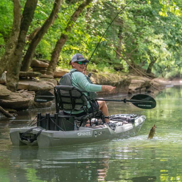 Kayak angler catching a fish from kayak