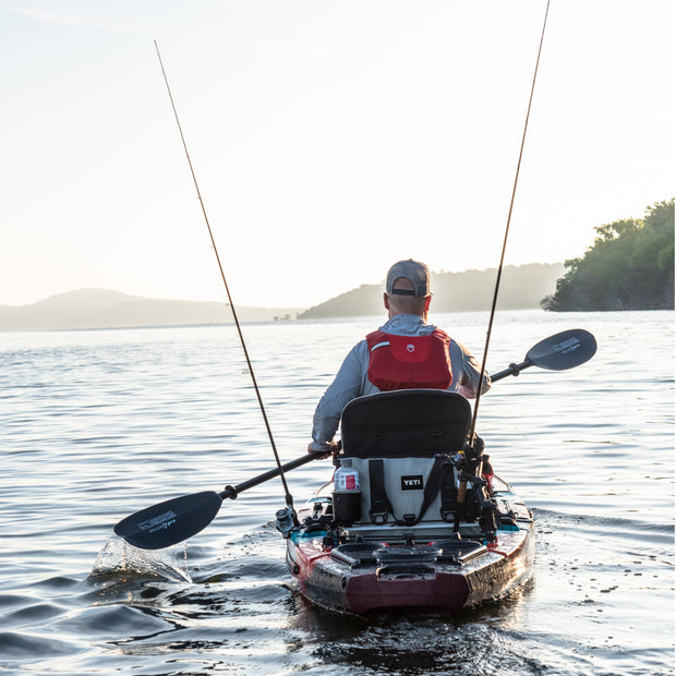 Kayak angler paddling towards the horizon