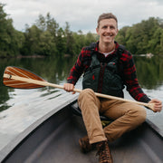Person holding Java canoe paddle in canoe