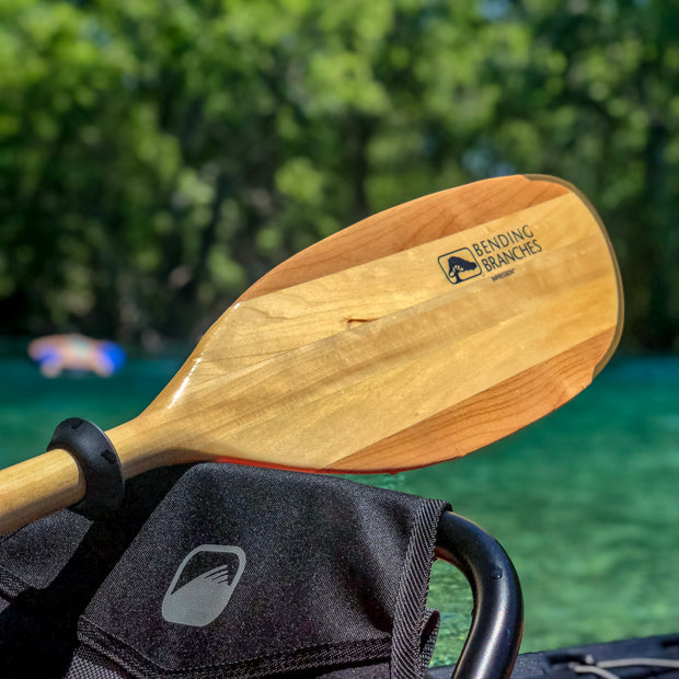 Impression kayak paddle blade resting on kayak seat