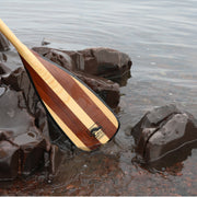 Cruise Plus canoe paddle blade near some rocks