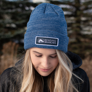 Girl wearing beanie looking down