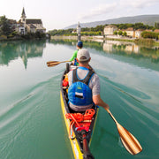 Two people in a canoe paddling a river in Europe