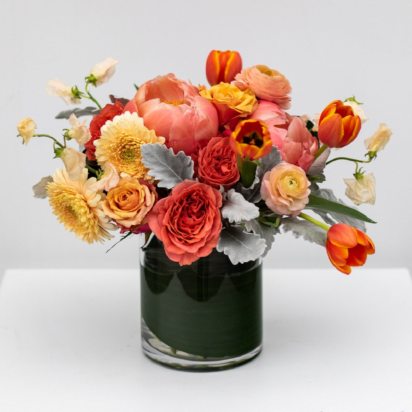 Mother's Day flower arrangement of peonies, roses, orange tulips, daisies and sweet peas