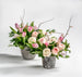 pink roses, blooming Quince, fragrant Freesia, Dutch tulips, ranunculus and fern
