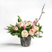 pink roses, blooming Quince, fragrant Freesia, Dutch tulips, ranunculus and fern flower arrangment