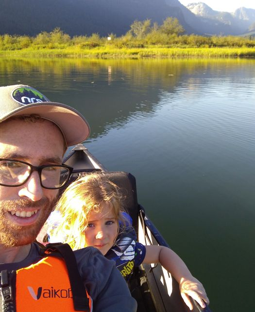 father and daughter paddling