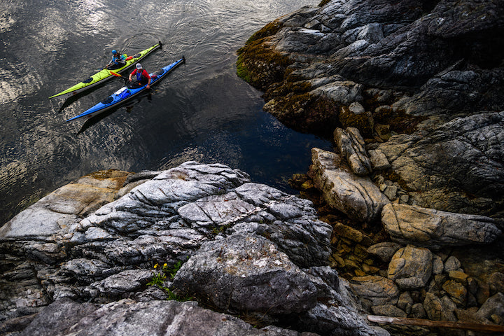 sea kayakers by the rocks