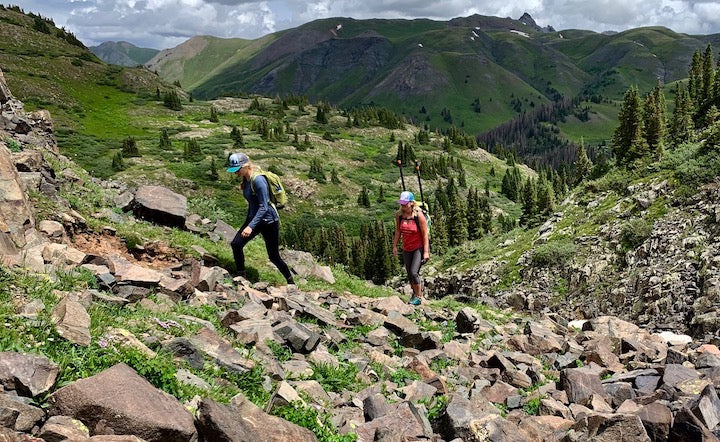 backpacking a packraft and paddles up the mountain