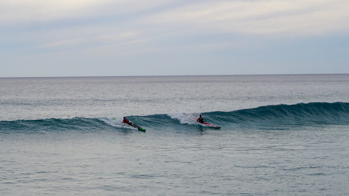 kayakers in surf