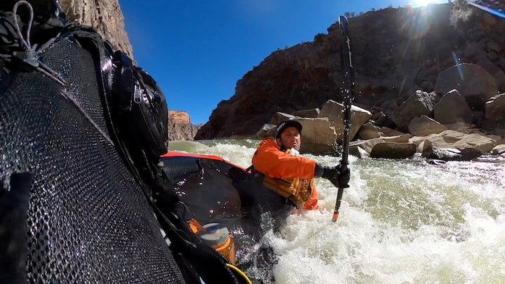 packrafter flipping into the rapids colorado river