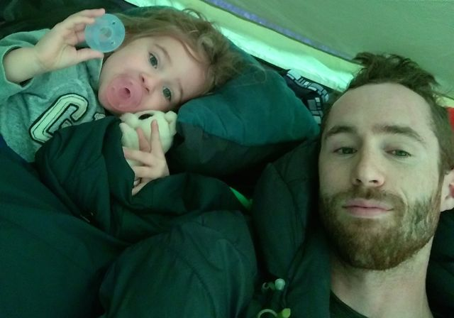 father and daughter in their tent