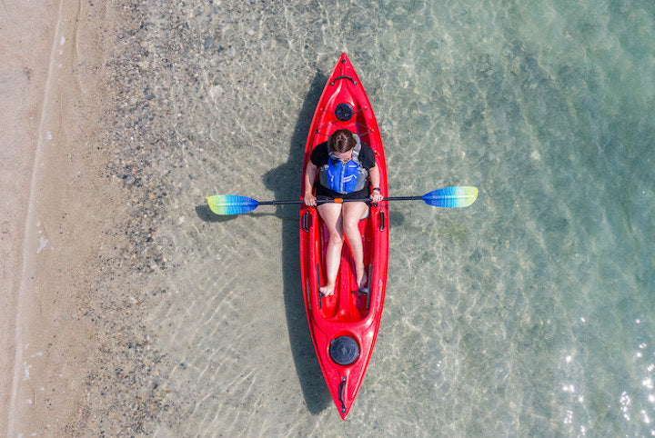 red kayak on the beach