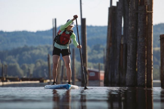 woman on stand-up paddleboard