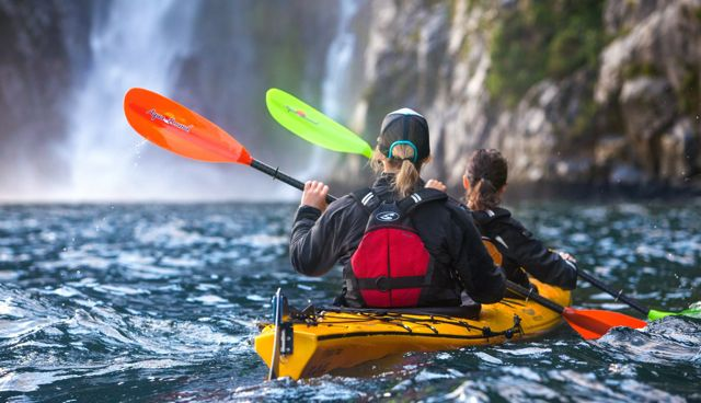 kayakers in milford sound