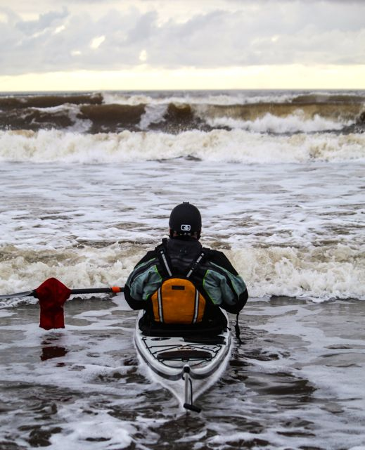 how to kayak ocean surf