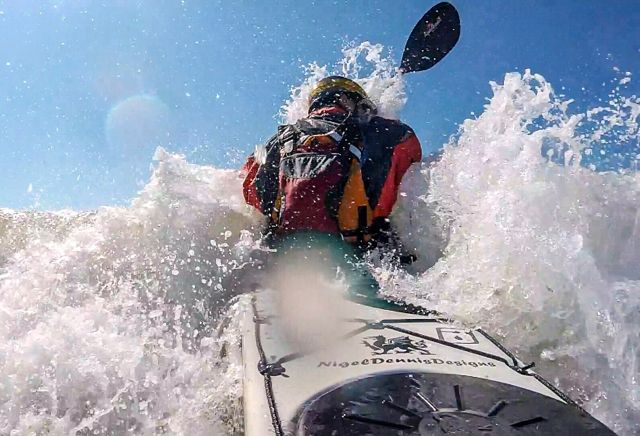 kayaker breaking through the surf zone