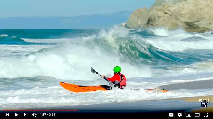 launch kayak in a surf zone
