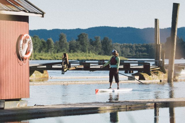 woman on a stand-up paddle board