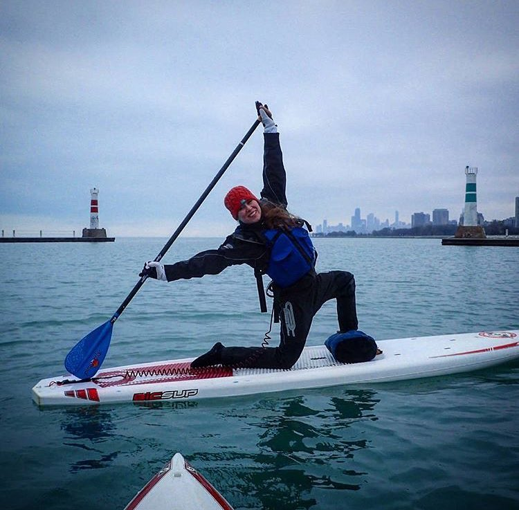 stand-up paddleboarder in an urban area