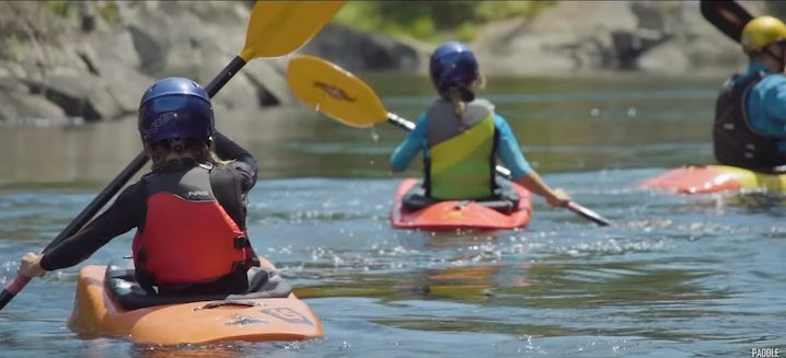 young girls whitewater kayaking