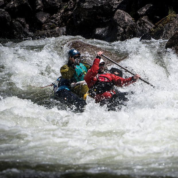 two people packrafting rapids