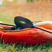 shred carbon whitewater kayak paddle laying on whitewater kayak