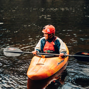 man in whitewater boat with shred carbon whitewater kayak paddle