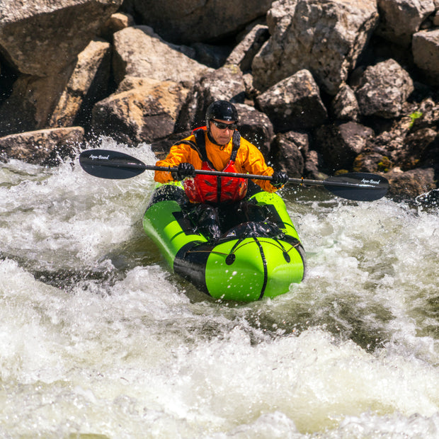 man packrafting down rapids with manta ray carbon kayak paddle