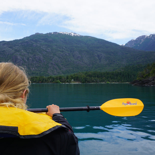 woman kayaking in the mountains with sting ray aluminum kayak paddle