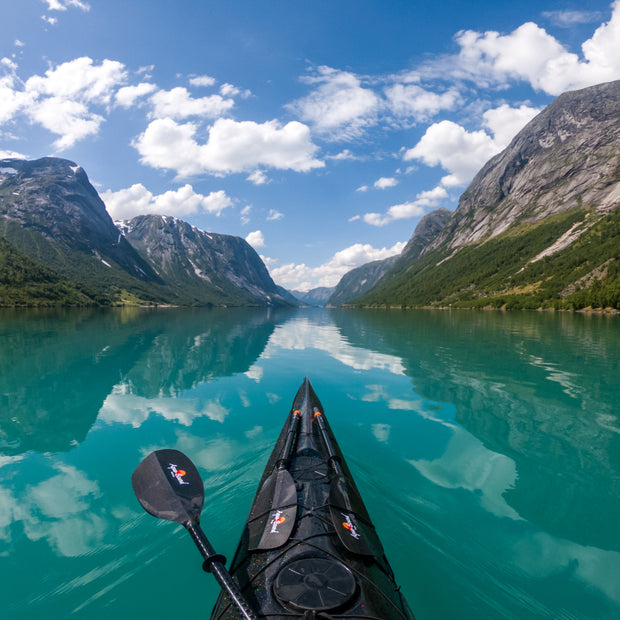 bow of black kayak in the fjords of Norway