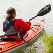 back view of woman kayaking with sting ray carbon kayak paddle