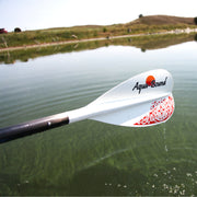 Lyric sup paddle being held out over the water