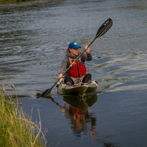 front view of man kayaking with a sting ray carbon kayak paddle