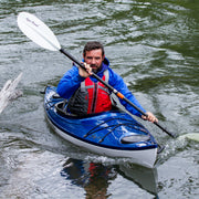 man kayaking with manta ray hybrid paddle