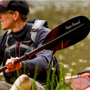 man kayaking showing back of sting ray carbon kayak paddle blade