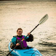 front view of woman kayaking with sting ray hybrid kayak paddle