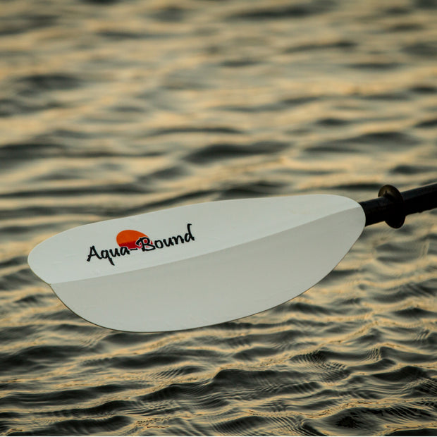 left blade of sting ray hybrid kayak paddle over water