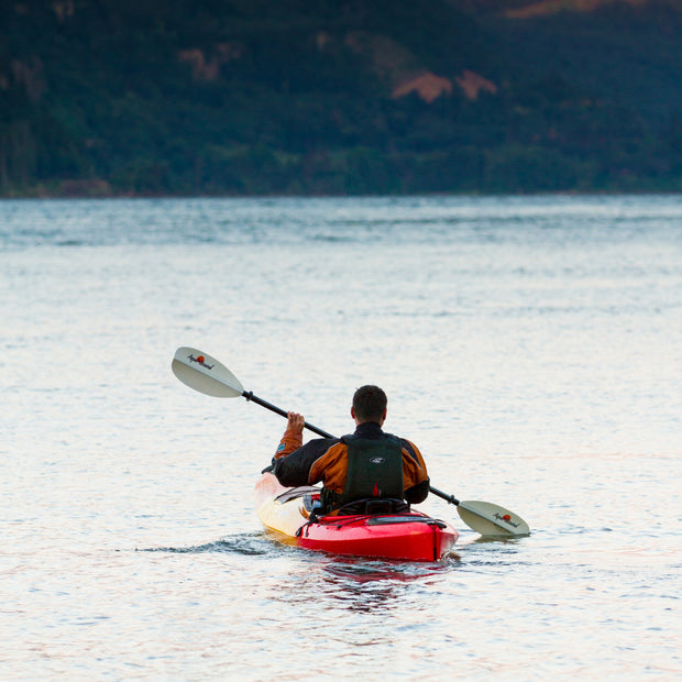 back view of woman kayaking with manta ray hybrid kayak paddle