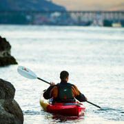 back side of woman kayaking with a manta ray hybrid kayak paddle