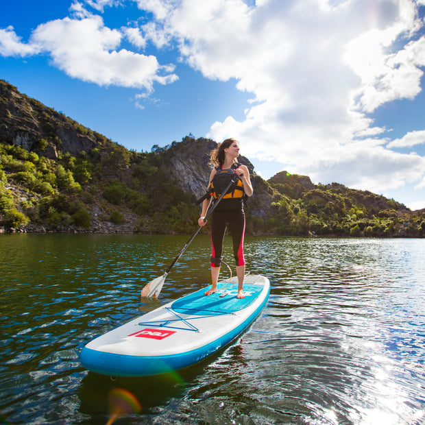 girl standing on paddle board with Lyric sup paddle