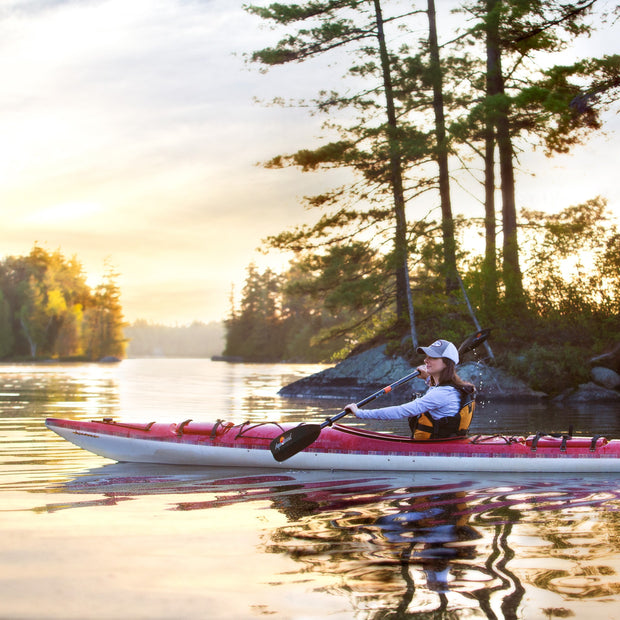 woman kayaking in the northwoods
