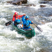 Two people canoeing through rapids with Edge canoe paddles