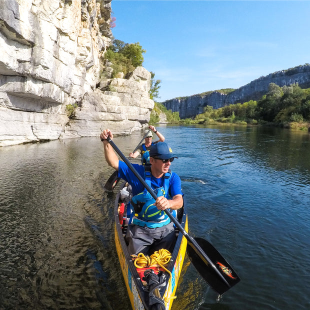 river canoeing along bluffs with Edge canoe paddle