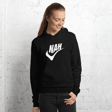 Female model wearing the Nah Black Hoodie - Funny Nike Parody Sports Shirt - Sportsball Supply Co.