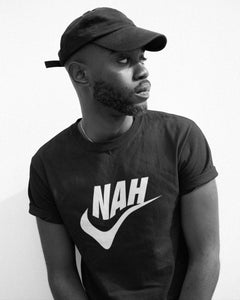 Male model wearing the Nah Unisex Tee - Funny Sports Nike Parody T-Shirt - Sportsball Supply Co.