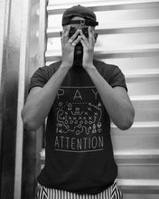 Male model wearing the Pay Attention Unisex Tee - Funny Sports T-Shirt - Sportsball Supply Co.