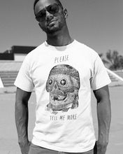Male model wearing the Please Tell Me More - Funny Snarky T-shirt in White - Sportsball Supply Co.
