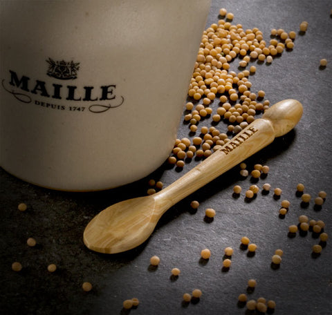 Maille mustard jar with mustard spoon and mustard seeds