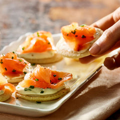smoked salmon blinis with black truffle mustard